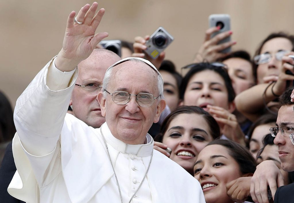 Pope Francis waves as he leaves at the end of the weekly general audience in Saint Peter's Square at the Vatican March 27, 2013. Holy Week is celebrated in many Christian traditions during the week before Easter. REUTERS/Tony Gentile (VATICAN - Tags: RELIGION)