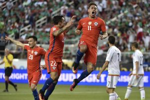 Chile's Eduardo Vargas (C) celebrates after scoring against Mexico during the Copa America Centenario quarterfinal football match in Santa Clara, California, United States, on June 18, 2016.  / AFP / OMAR TORRES        (Photo credit should read OMAR TORRES/AFP/Getty Images)