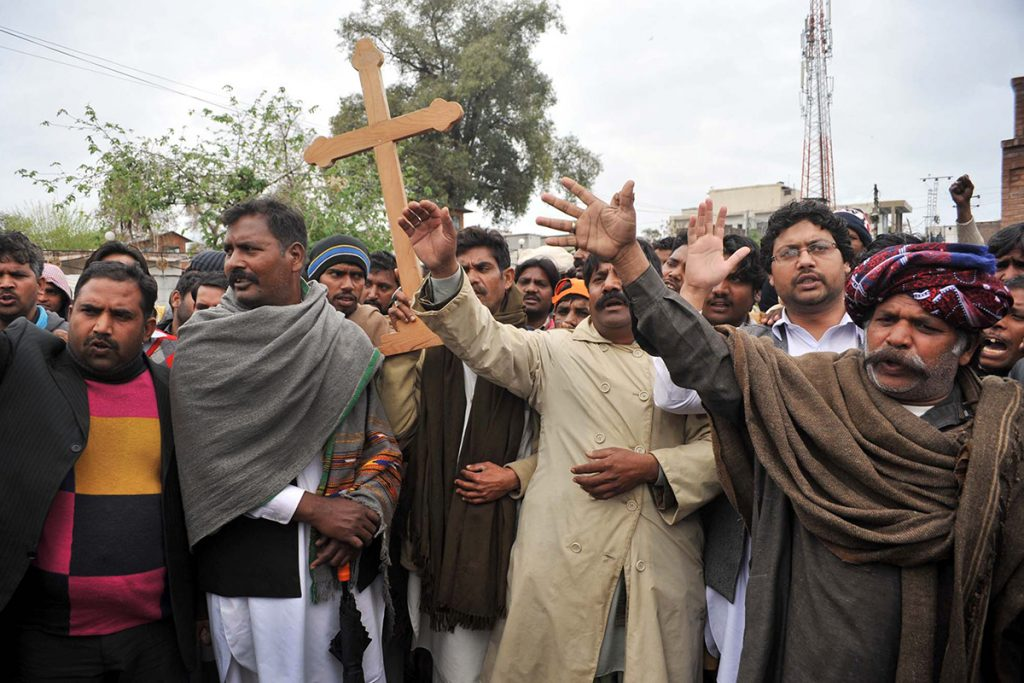 PESHAWAR, PAKISTAN - MAR 16: Christian Community chant slogans against Twin blasts targeted the Roman Catholic Church and Christ Church in Youhanabad area of Lahore on March 16, 2015 in Peshawar.